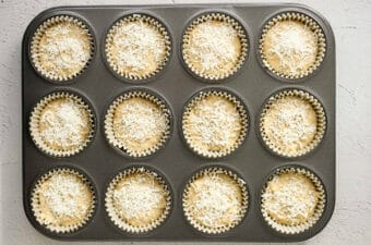 unbaked lemon chia muffins in muffin pan
