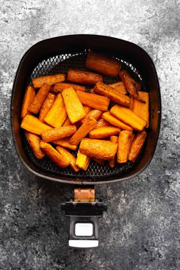 overhead view of carrots in air fryer basket