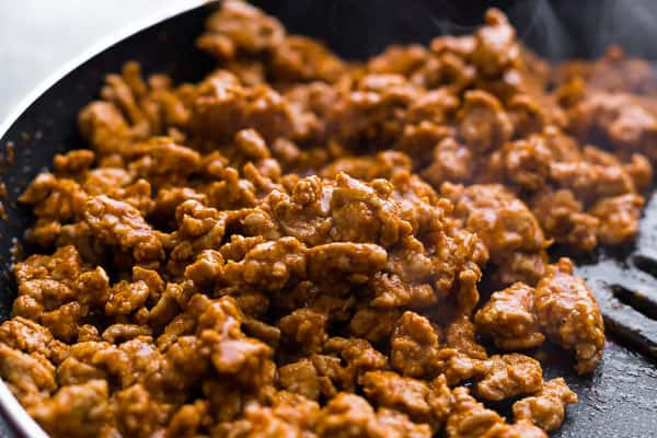 ground turkey being cooked in frying pan