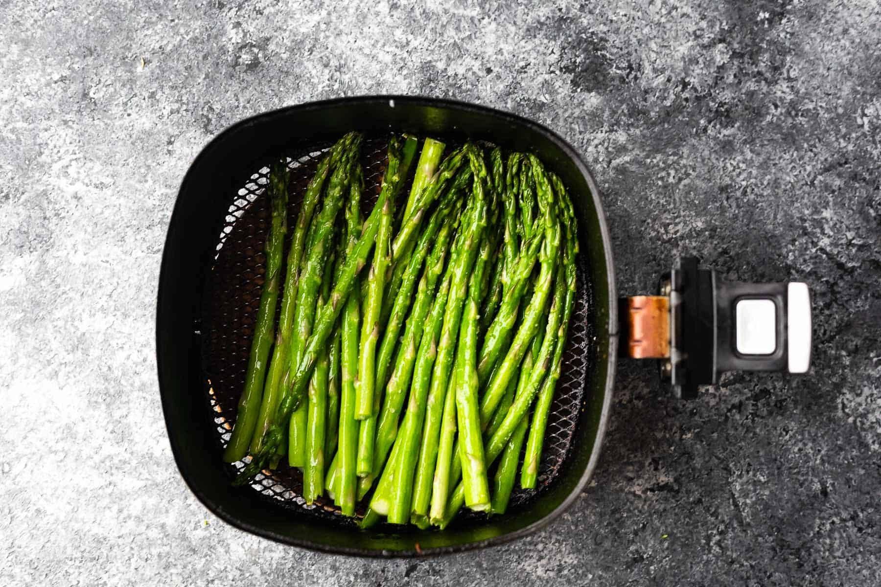 asparagus in an air fryer basket