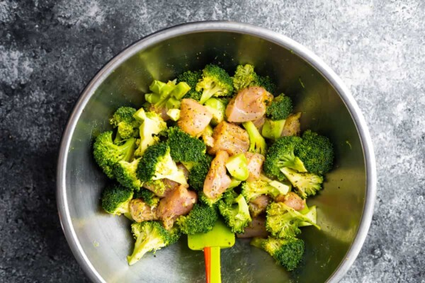 lemon pepper chicken and broccoli mixed up in silver bowl