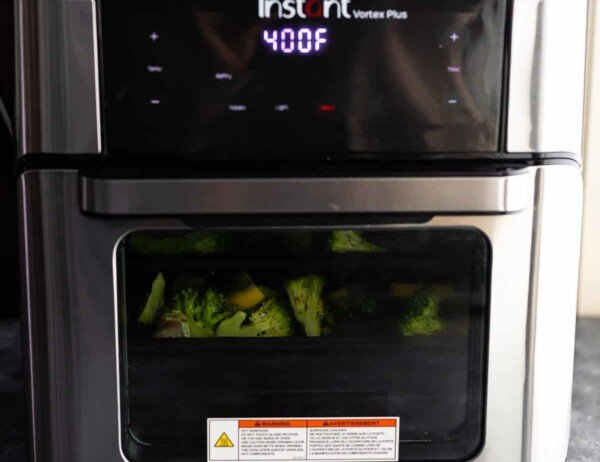 lemon pepper chicken and broccoli inside the air fryer oven