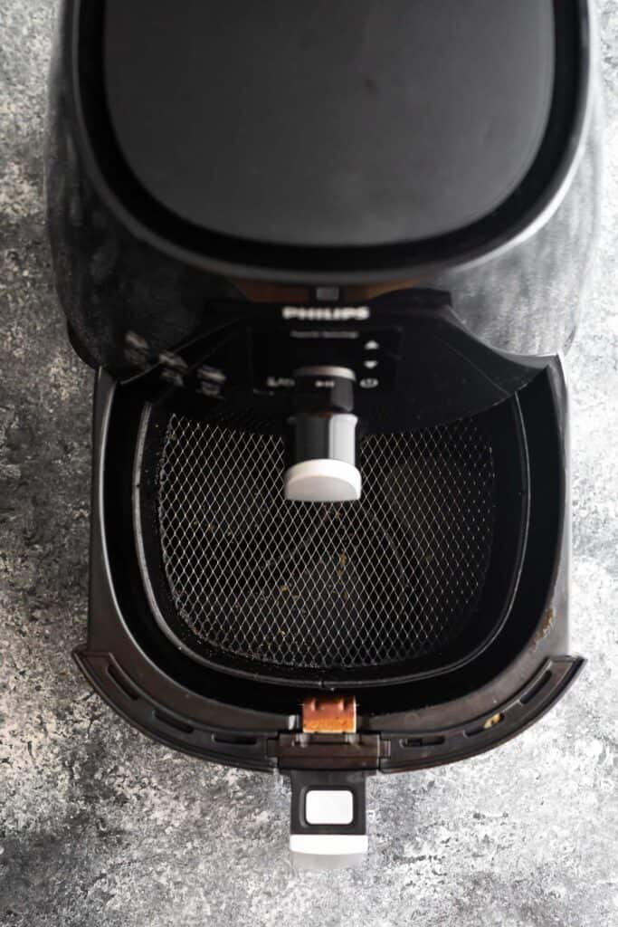 overhead view of philips air fryer basket showing basket partially out