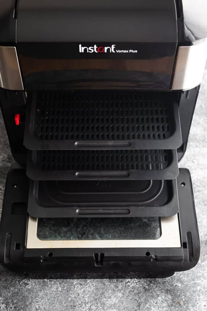 overhead view of instant pot air fryer vortex oven with trays partially out
