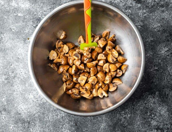 mushrooms tossed in sesame oil and soy sauce in a bowl