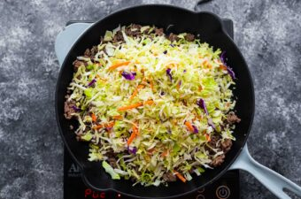overhead view of egg roll in a bowl in a pan before stirring slaw up