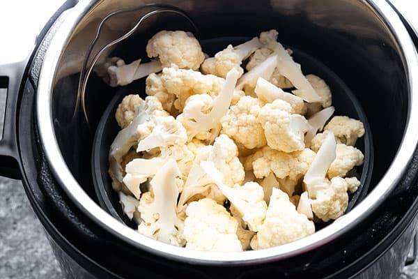 cauliflower in steamer basket in instant pot