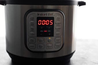 instant pot with timer set to 5 minutes