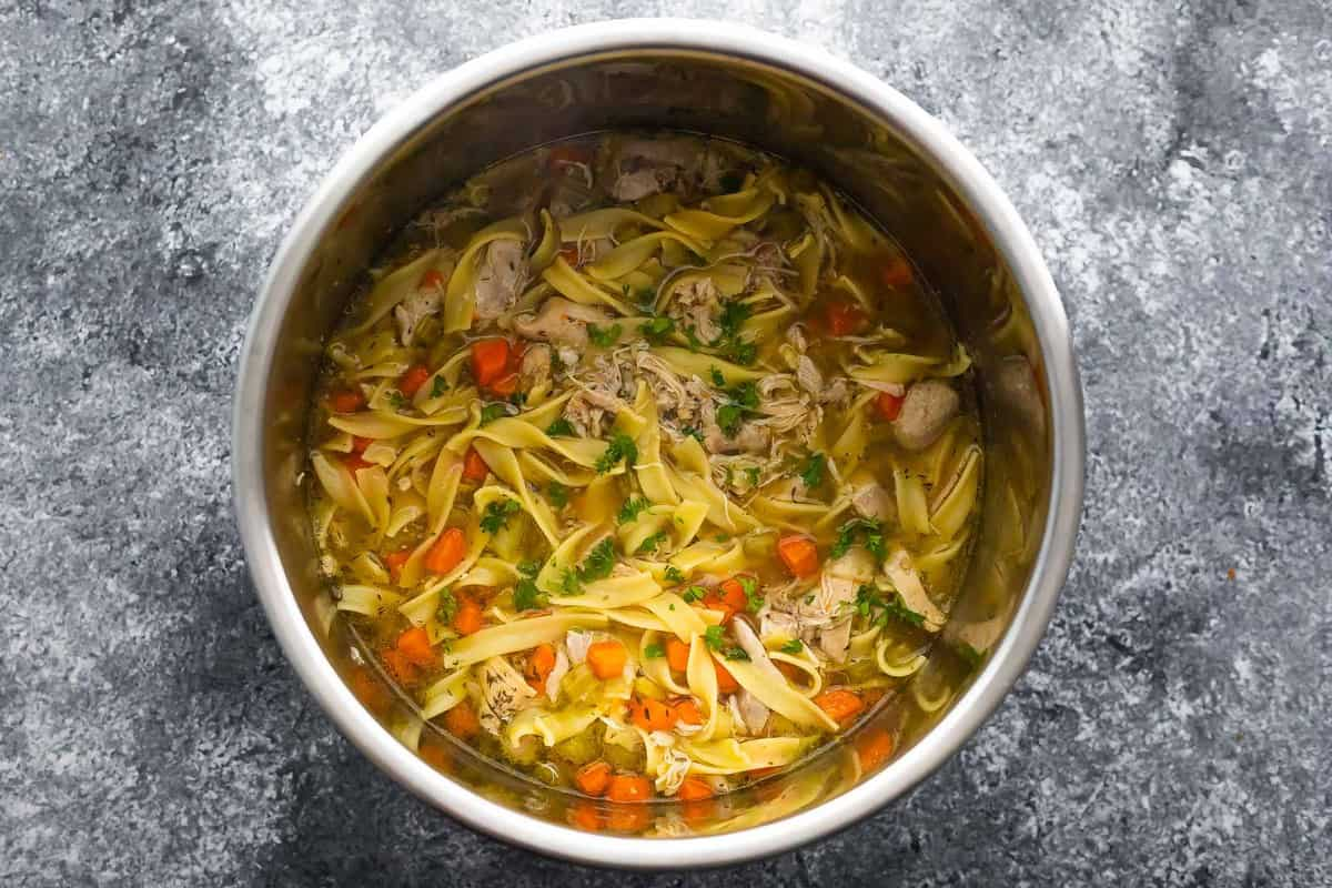overhead view of chicken noodle soup in the Instant Pot