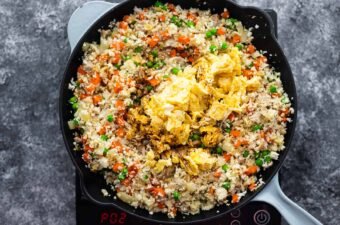cauliflower fried rice with scrambled eggs and soy sauce added on top