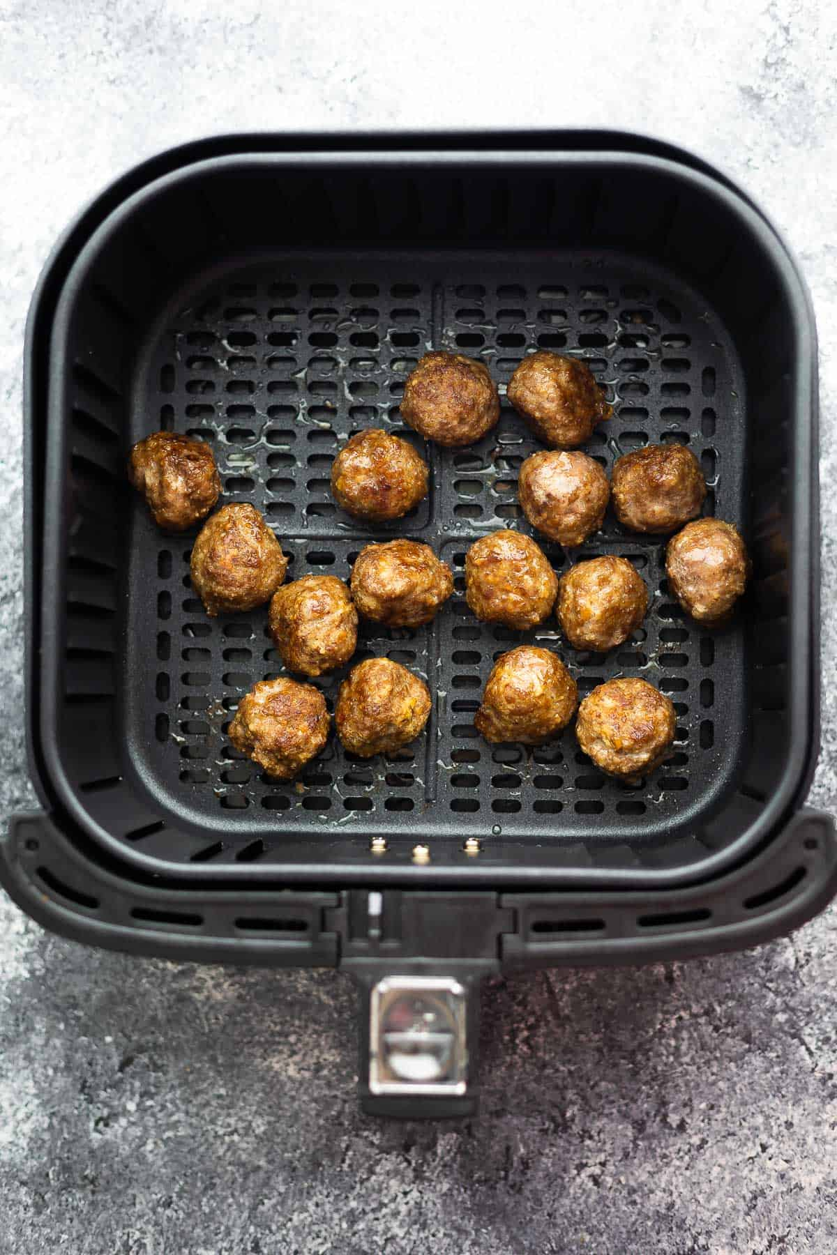 cooked meatballs in air fryer basket