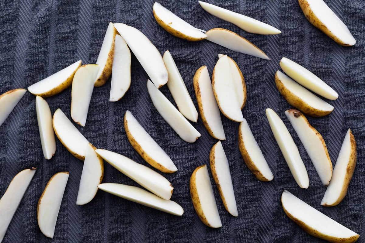 potato wedges drying on tea towel