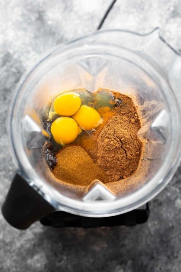 overhead view of ingredients for black bean brownies in a blender (before blending)