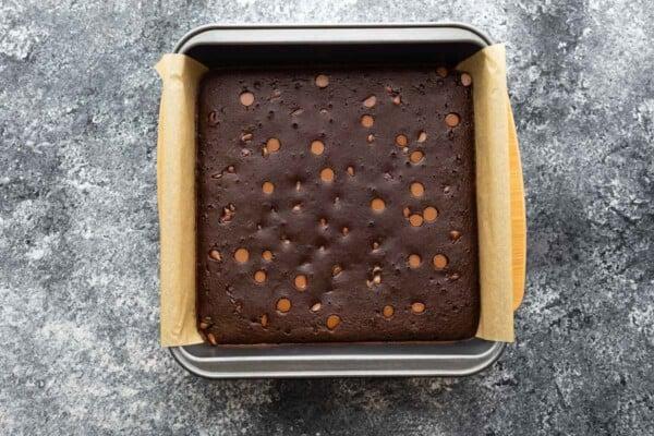 overhead view of black bean brownies in baking pan after baking through