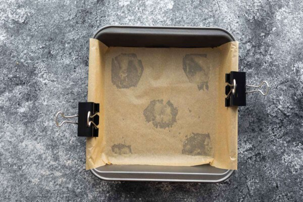 8 x 8 inch baking pan lined with parchment paper and clipped in place