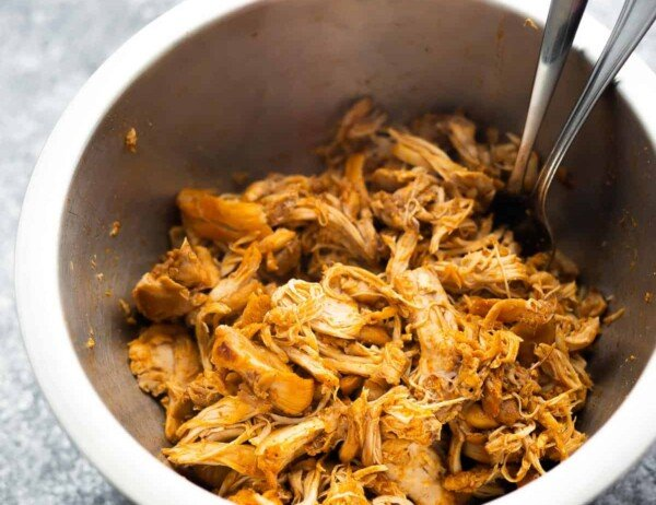 shredded chicken in bowl with forks