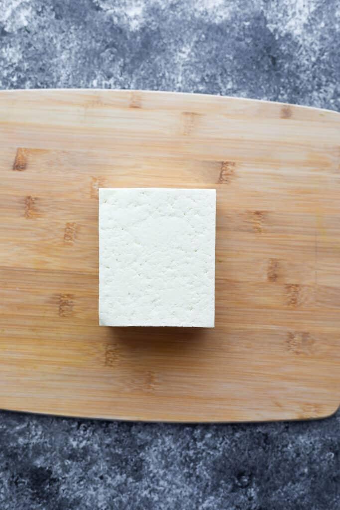 block of tofu on cutting board