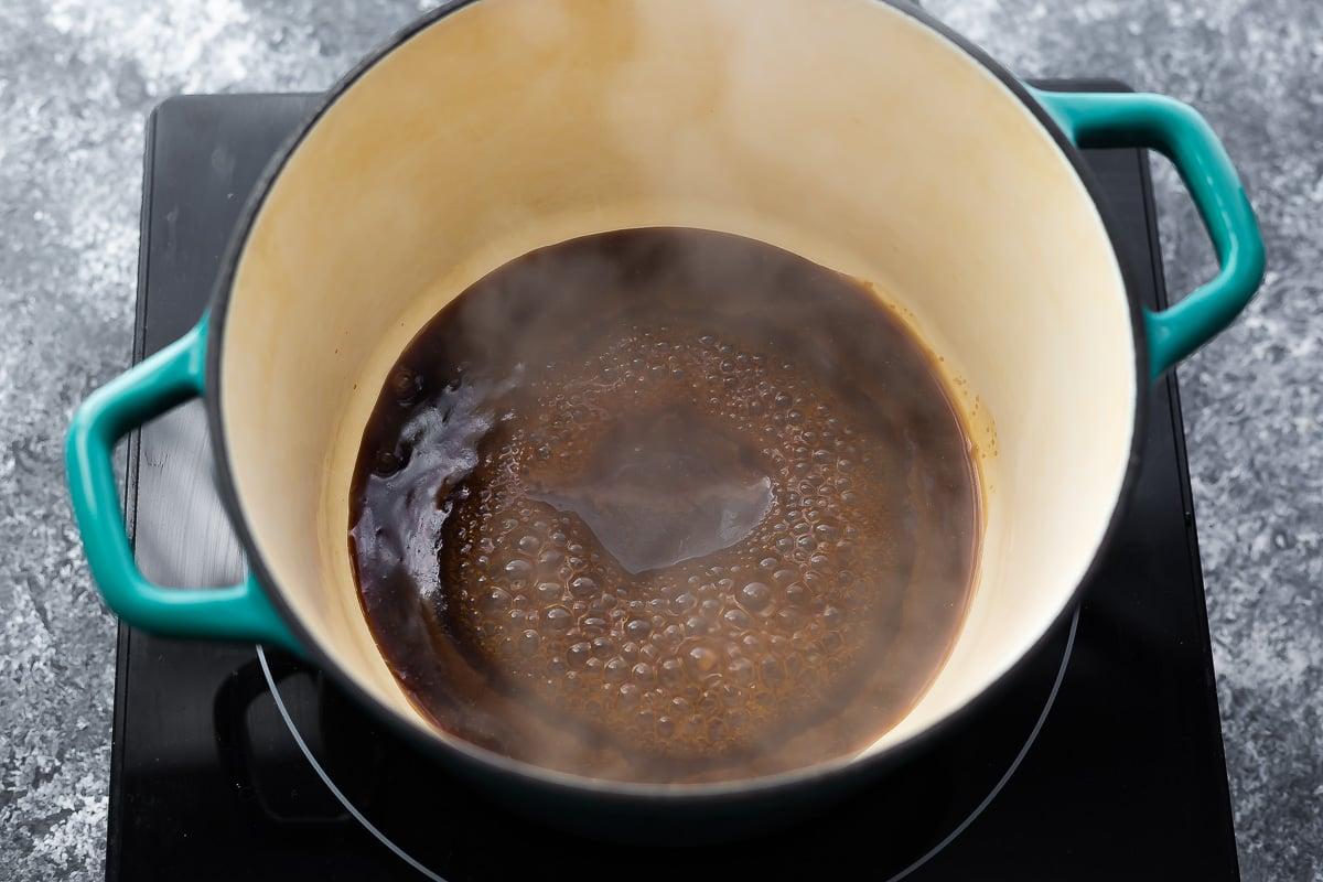 reducing balsamic marinade in blue pot