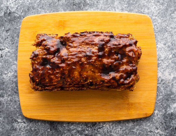 turkey meatloaf brushed with hoisin sauce on cutting board