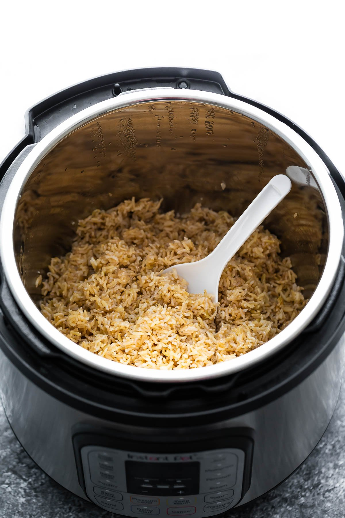 rice paddle in instant pot with cooked brown rice