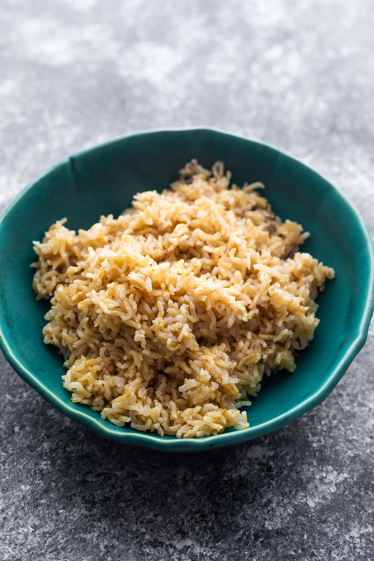 brown rice in blue bowl