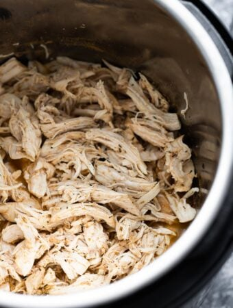 close up shot of shredded chicken in the instant pot