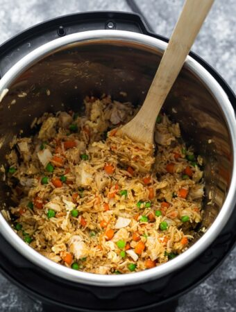 fried rice in instant pot with wooden spoon