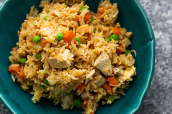 overhead view chicken fried rice in blue bowl