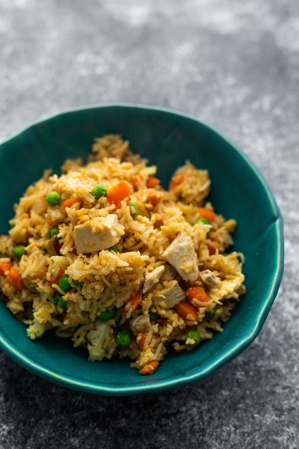 fried rice in blue bowl close up shot