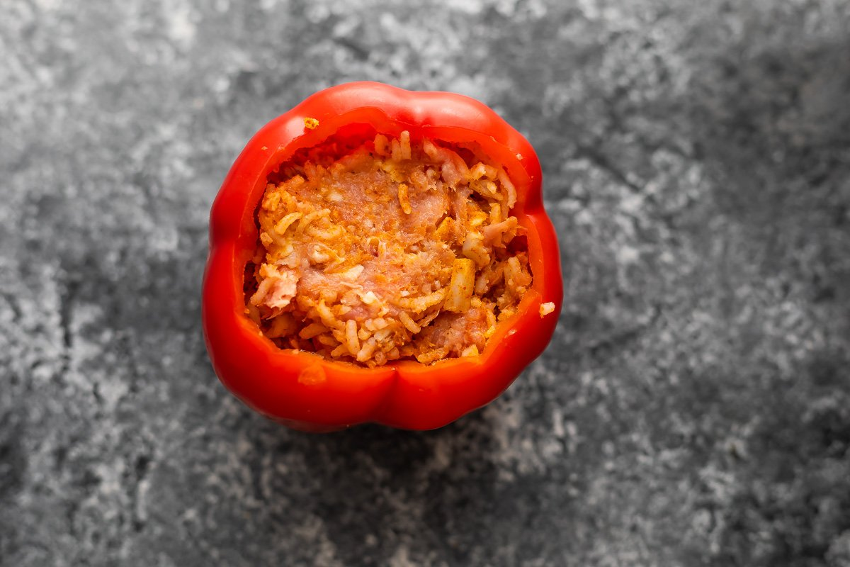 stuffed pepper (uncooked) on grey surface