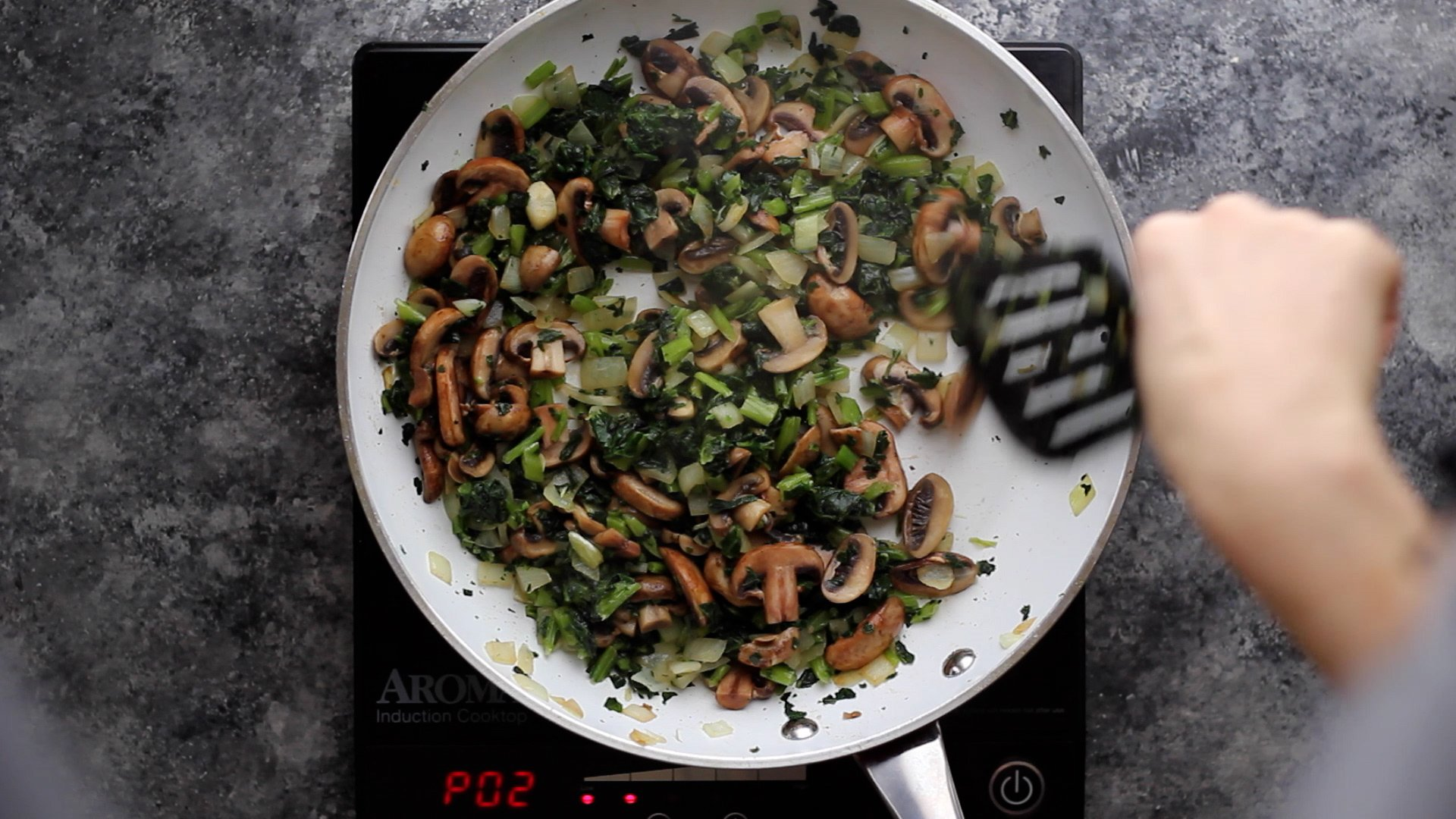 sauteeing onions, mushrooms and kale