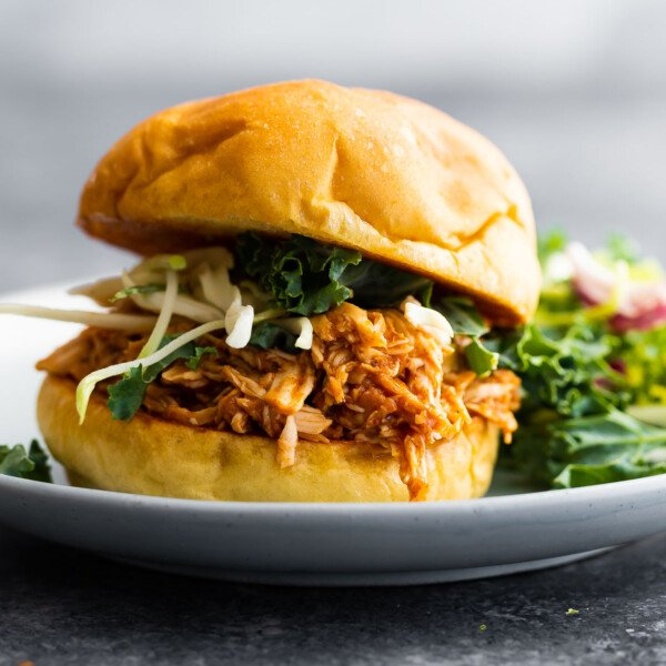side angle view of bbq chicken sandwich on plate