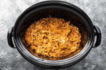 overhead view of bbq chicken in slow cooker after cooking