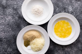 three bowls with flour, eggs, and panko
