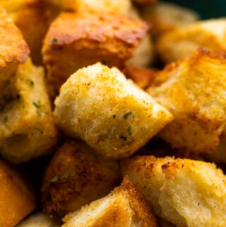 close up shot of air fryer croutons in bowl