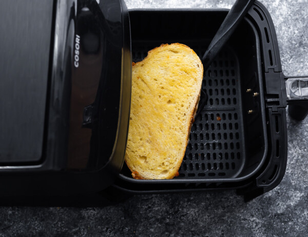 flipping the grilled cheese over in air fryer basket