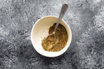 seasoning blend in white bowl with spoon