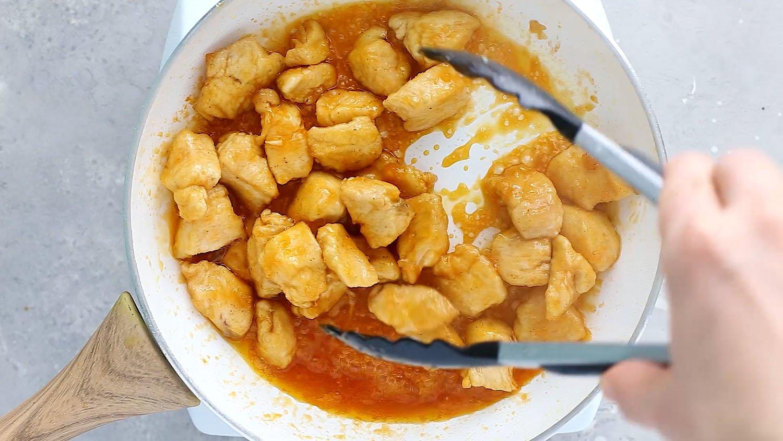 stirring firecracker chicken in sauce