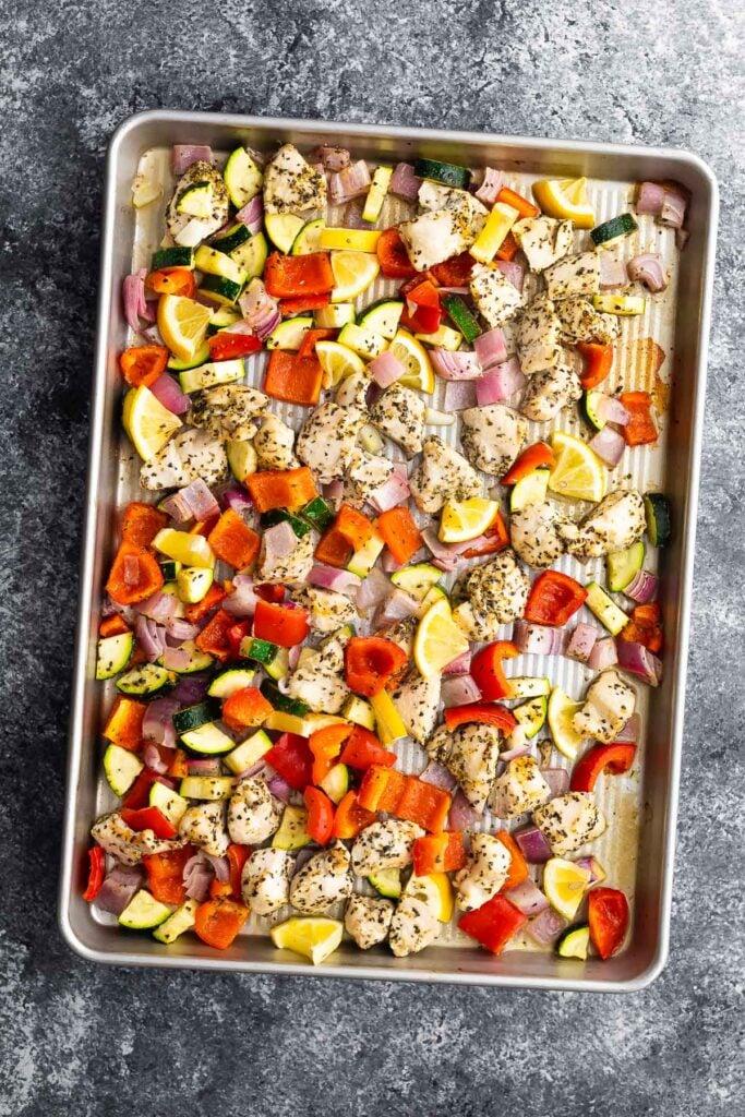 cooked greek chicken wrap filling on sheet pan