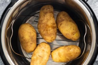 overhead view of 5 potatoes in instant pot before cooking