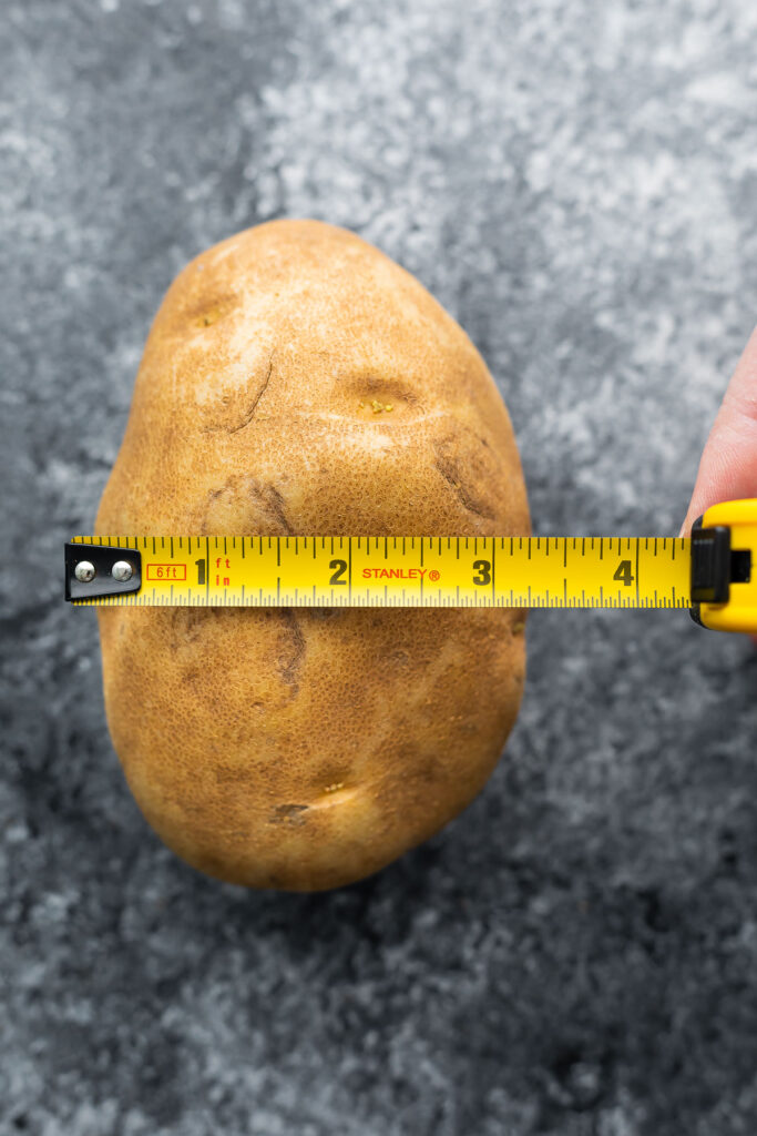 potato with measuring tape measuring 3.5 inches