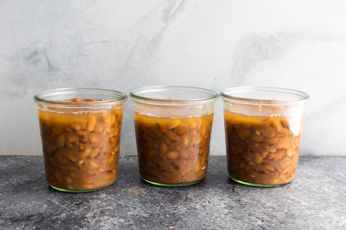 three jars filled with pinto beans