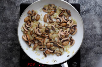 sauteeing mushrooms and onions in pan