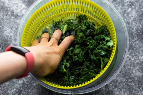 massaging kale in a salad spinner