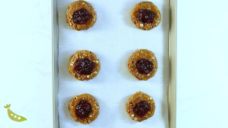 pb & j breakfast cookies on baking sheet before baking