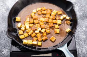 tofu simmering in peanut sauce