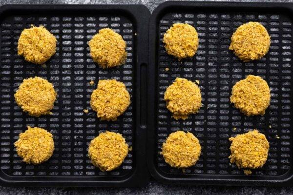 falafels on air fryer rack before cooking