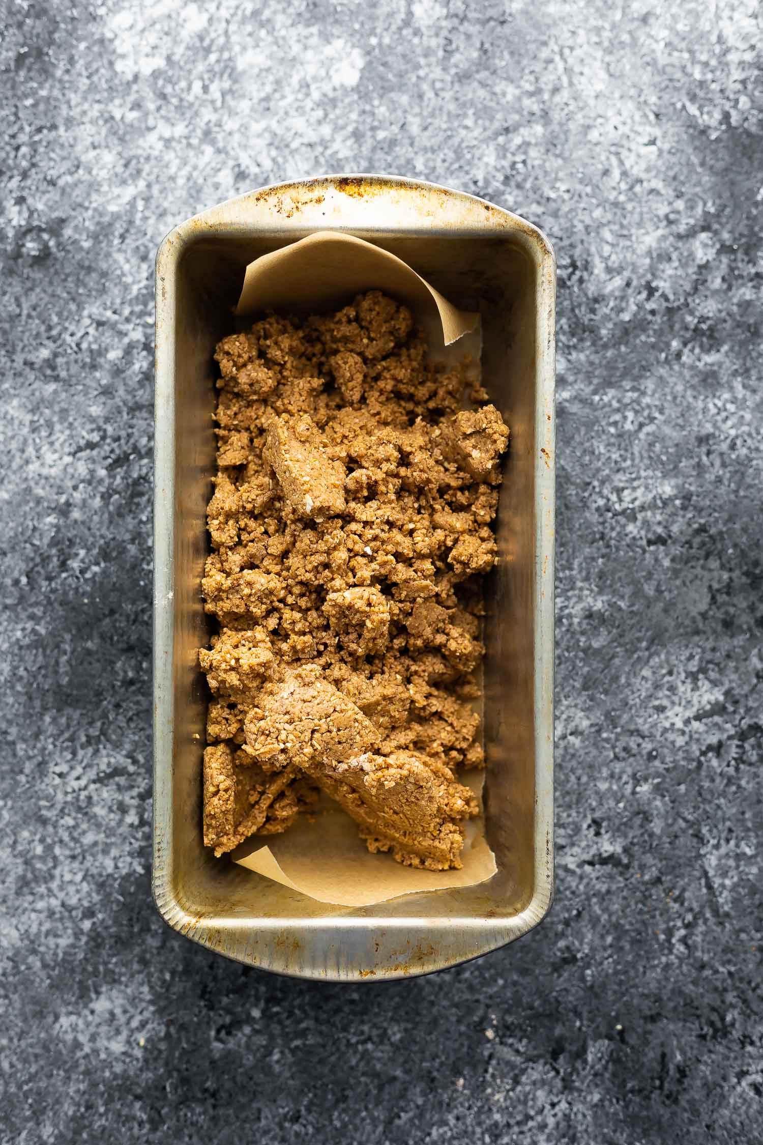 protein bar mixture in loaf pan before pressing