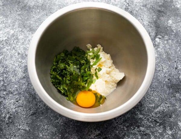 ricotta, basil, egg and salt in bowl