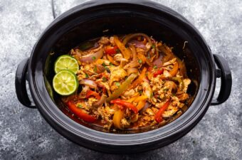 slow cooker chicken fajitas in the slow cooker after cooking through